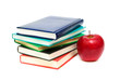 a stack of books and a red apple on a white background