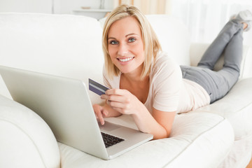 Cute woman using a notebook to buy online