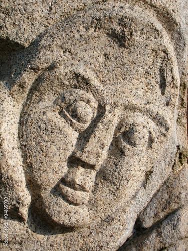 Leinwanddruck Bild Freundliches Skulptur Gesicht