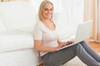 Portrait of a fair-haired woman with a laptop