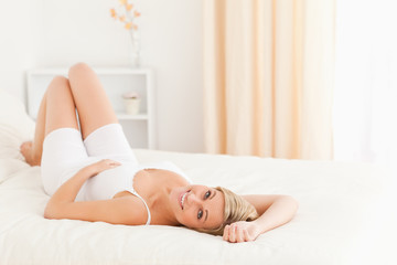 Cute woman posing on her bed