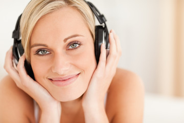 Close up of a woman wearing headphones