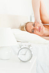 Portrait of a woman awaked by her alarm clock