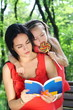 Little girl and mother reading the book.
