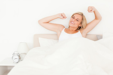 Blonde woman stretching her arms