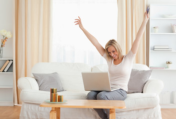 Cheerful woman shopping online