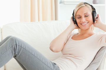Serene woman listening to music