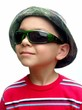 kid with green sunglasses and camo hat