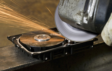 working with angular grinder on open hard drive