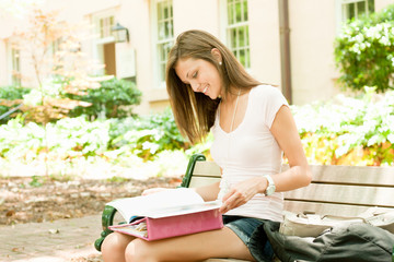 A pretty young student with study materials