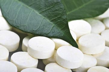 Pills closeup on the leaf..