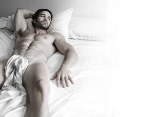 Sexy hunk in bed