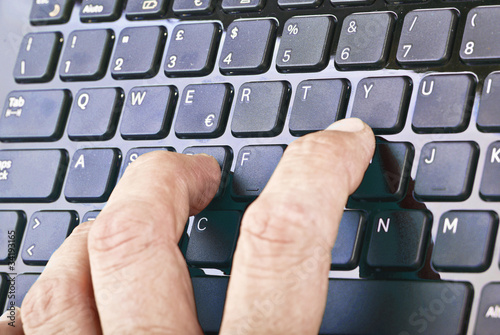 Hands on keyboard while writing