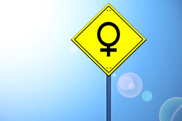 Female gender on road sign