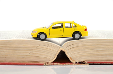 Toy car and dictionary