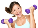 Happy fitness woman lifting dumbbells - 34199555