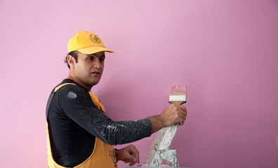 painting a wall pink by painters construction workers