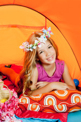 Children fashion little girl lying indoor of camping tent
