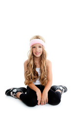 Children gym little blond girl posing in studio