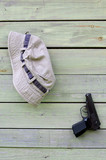 Hat and Pistol on Shabby Wooden Wall