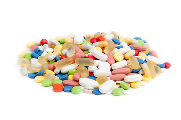 pills over white. Colorful tablets with capsules.