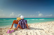 Couple in hug looking together on the Caribbean Sea