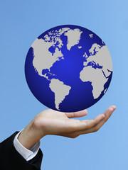 Business hand holding world