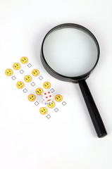 Smile face and magnifier with dices