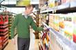 Man buying juice in the market