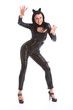 Sexy young woman in black full body pvc cat suit