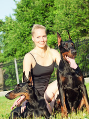 pretty women with own dobermans