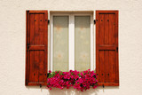 Window adorned with flowers poster