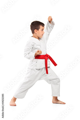 Full length portrait of a karate kid posing