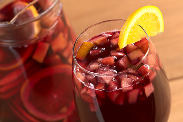 Refreshing red wine punch called sangria with fresh fruits