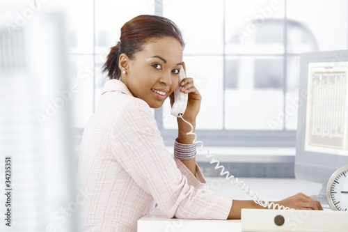 Happy office worker on phone
