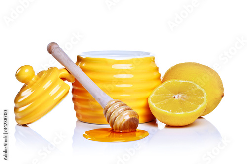 Honey and lemon isolated on a white background.