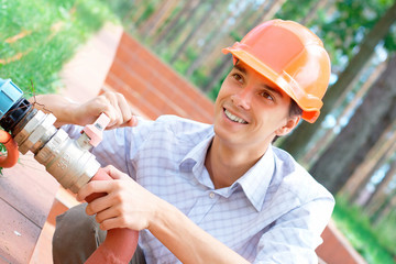 Worker  repairing a pipe