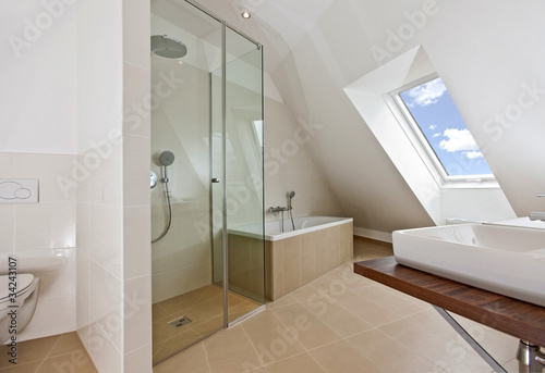 sunlit bathroom with roof top window