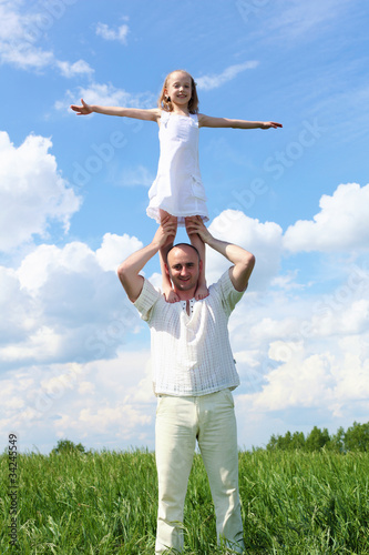 father with daughter in summer day outdoors