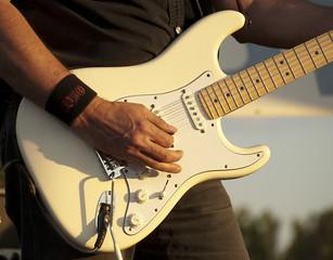 Man playing electrical guitar-close up