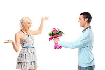 Boyfriend giving flowers to his surprised girlfriend