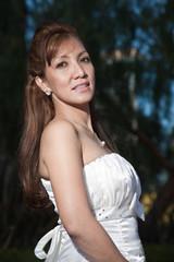 Attractive asian filipino bride in gown