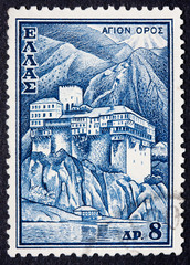 A Greek stamp showing a building in the mountains