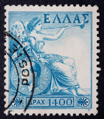 A Greek stamp showing a reclining woman