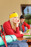 Tramping young couple relax by wooden table poster