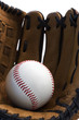 Closeup of baseball glove holding baseball