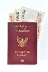 Thailand passport with banknotes