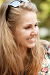 Closeup portrait of a happy young women smiling
