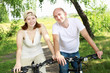 Young couple on the bikes in the park