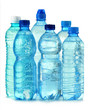 Polycarbonate plastic bottles of mineral water isolated on white